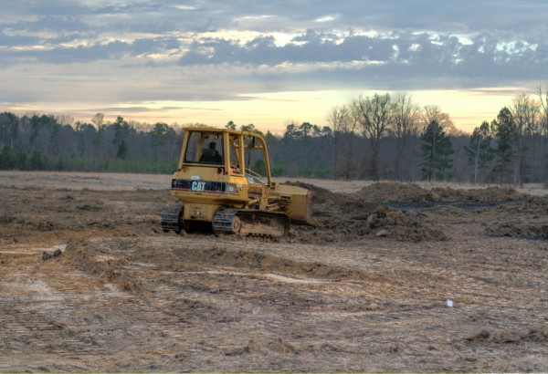 Moving dirt at the new church site.